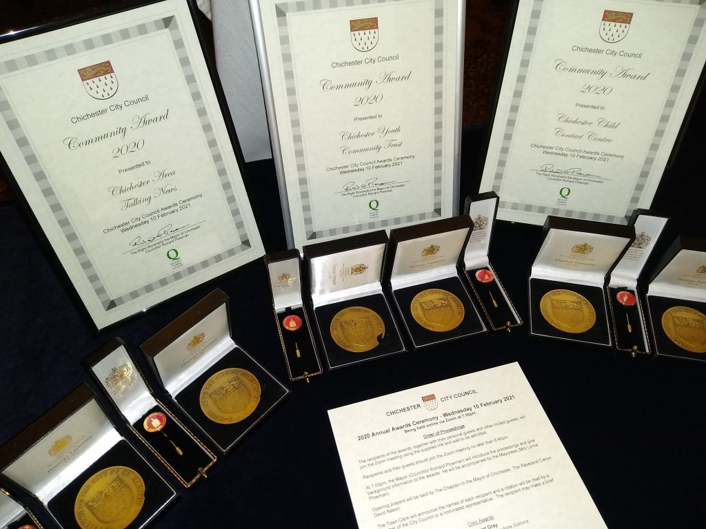 Chichester City Council Civic Awards certificates, medals and pins on display prior to 2020 ceremony