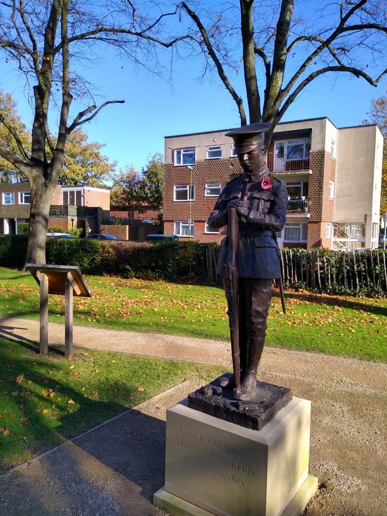 Litten Gardens - Maurice Patten statue - front view