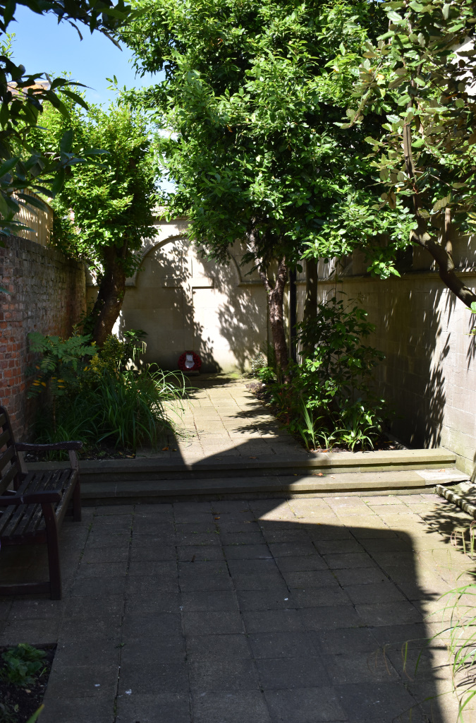 West Street disused burial ground in the sun